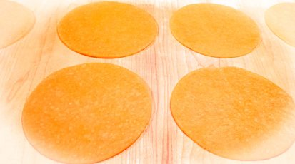 The dough, rolled out and cut into circular shapes