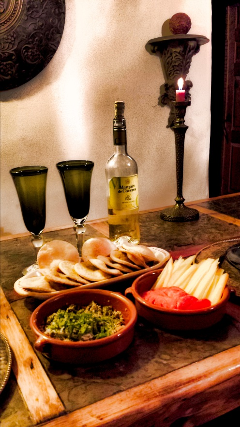 Tortas de aceite, served tapas style and accompanied by a hearty Spanish white wine