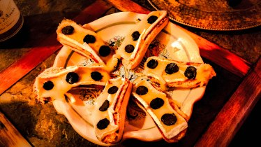 French bread topped with gently melted triple-creme brie and black truffles