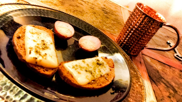 Rye toasts with melted English cheddar served with beet-pickled eggs and accompanied by a chilled mug of hard apple cider