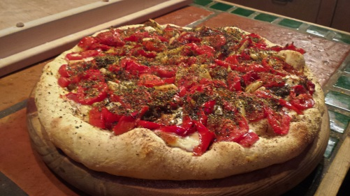 Pizza with roasted red bell pepper and tomato