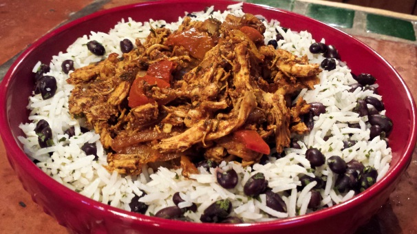 Pollo en Adobo served with Black Beans and Rice
