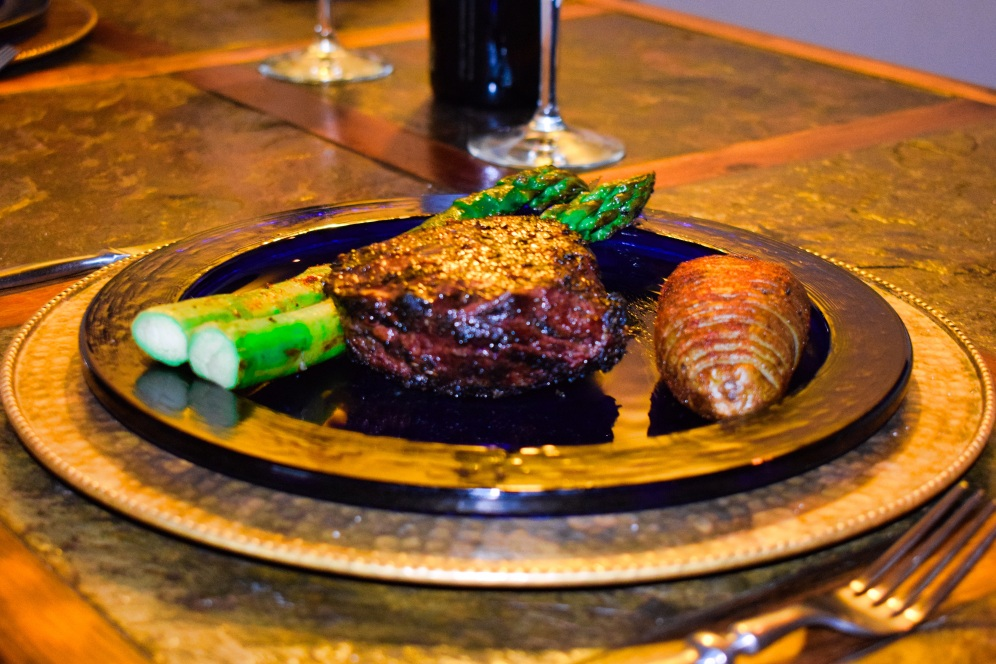 The main course ~ Brazilian-style steaks accompanied by grilled asparagus spears and roasted potatoes