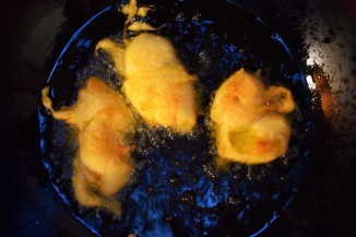 Banana biegnets frying in olive oil