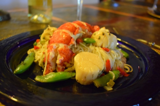 Plated dinner of giant lobster and jumbo sea scallops with pasta
