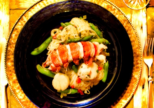 Lobster & scallops with vegetables over angel-hair pasta
