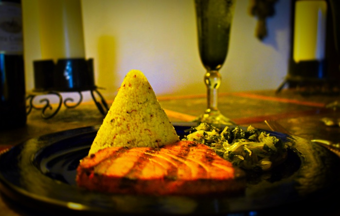 Wood-grilled tuna steaks accompanied by saffron couscous and zucchini