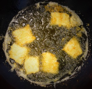 Cod filets deep frying in extra virgin olive oil
