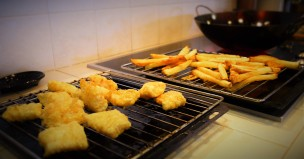 Place the fries and fish on racks to allow excess oil to drip