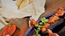 Souvlaki with homemade pita bread and tomato salad